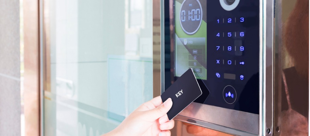Touchless technology a contactless key is used to open a modern door