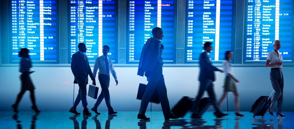 Future of business travel: business travellers walk through an airport